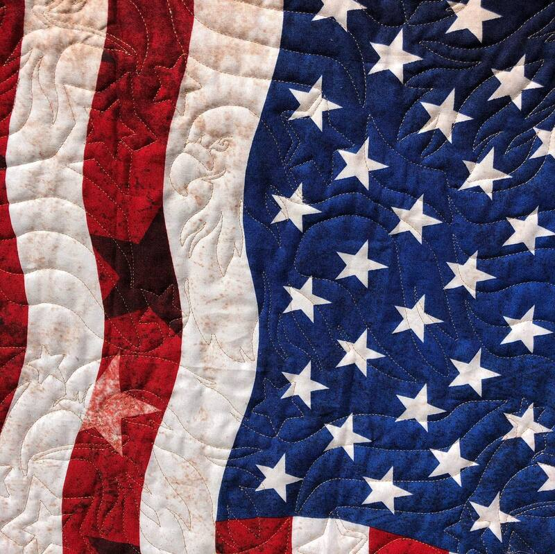 Patriotic quilt, machine quilted by Amy Martin of Peaceful Quilts in Lafayette Indiana